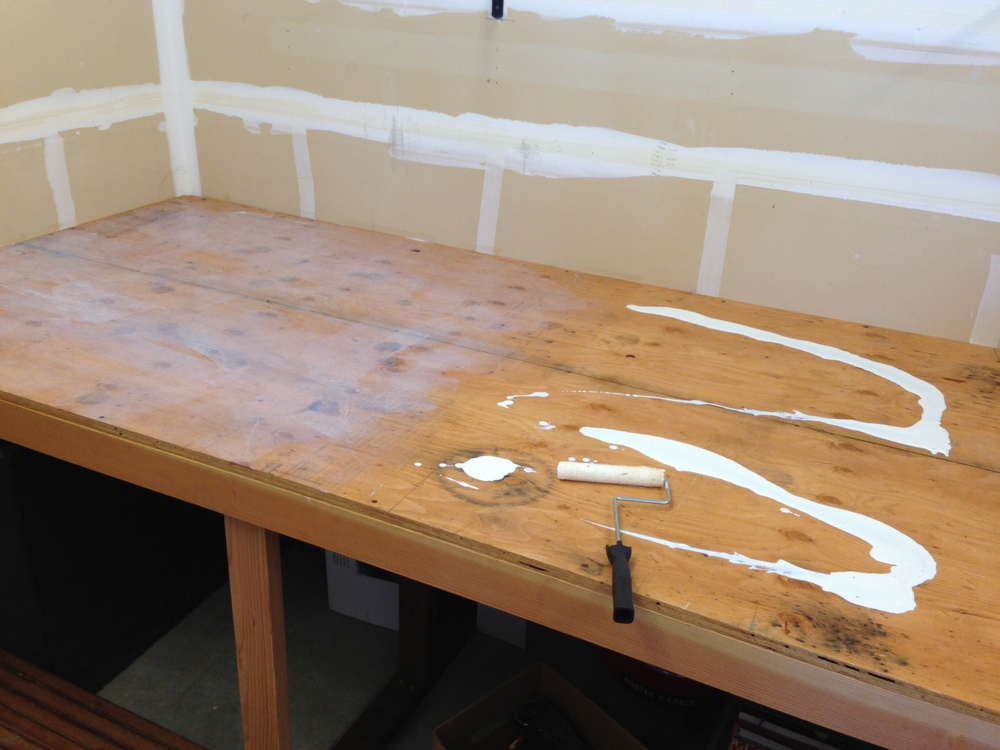 I used a 2 gallon can of contact cement to adhere a smooth top to the plywood.