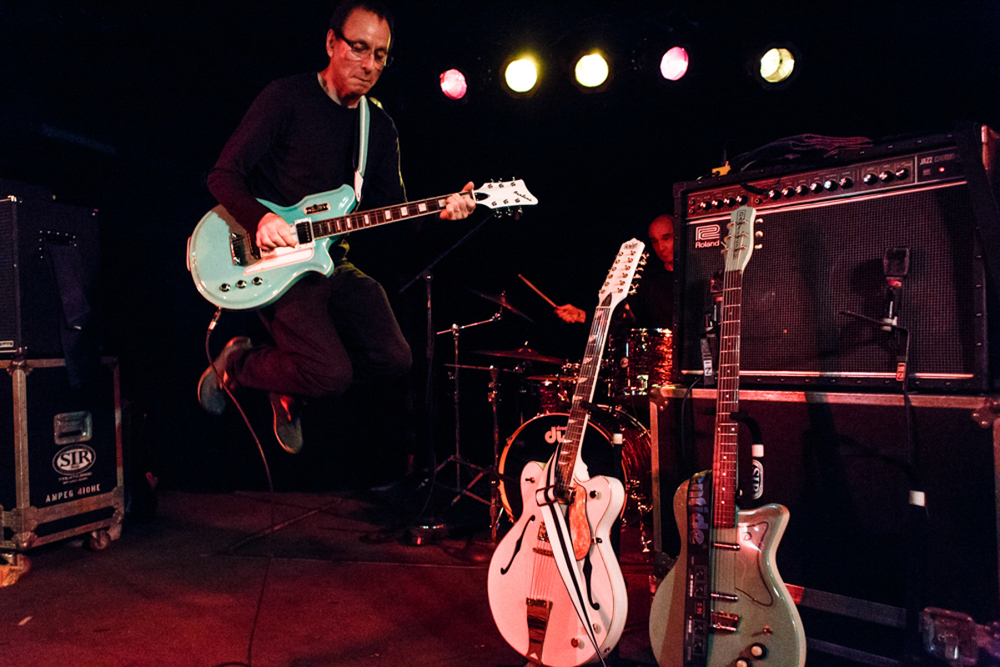 Wire guitarist Colin Newman catching some air at the Black Cat - 6/6/15 (photo by Matt Condon)