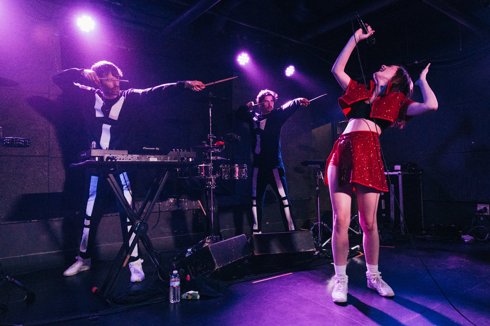 Julie Budet caught red-handed by her bandmates at U Street Music Hall (Photo by Mauricio Castro /  @themauricio )