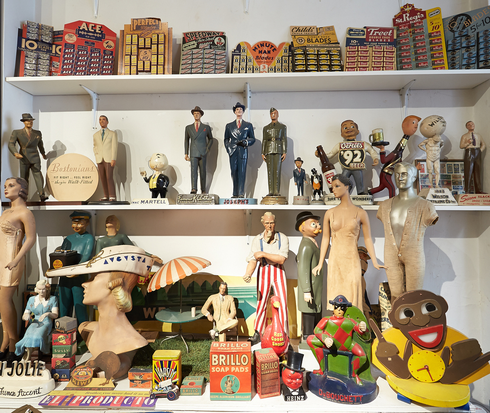 Before there was Etsy.com there was Esky, the 1940's Esquire Magazine Man (middle shelf, tiny figure just to the right of center). PLUS: Razor Blade displays, micro mannequins, one of many Uncle Sam's in Steve's collection. (Click on photo to enlarge).