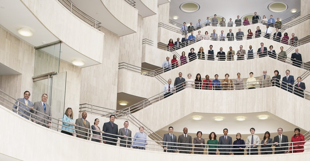 74 of the URS people responsible for engineering the United States Courthouse in Brooklyn, photographed early on a Sunday morning in the courthouse's cavernous lobby. To get the detail and quality required my four assistants and I spent hours setting up hundreds pounds of lighting equipment.