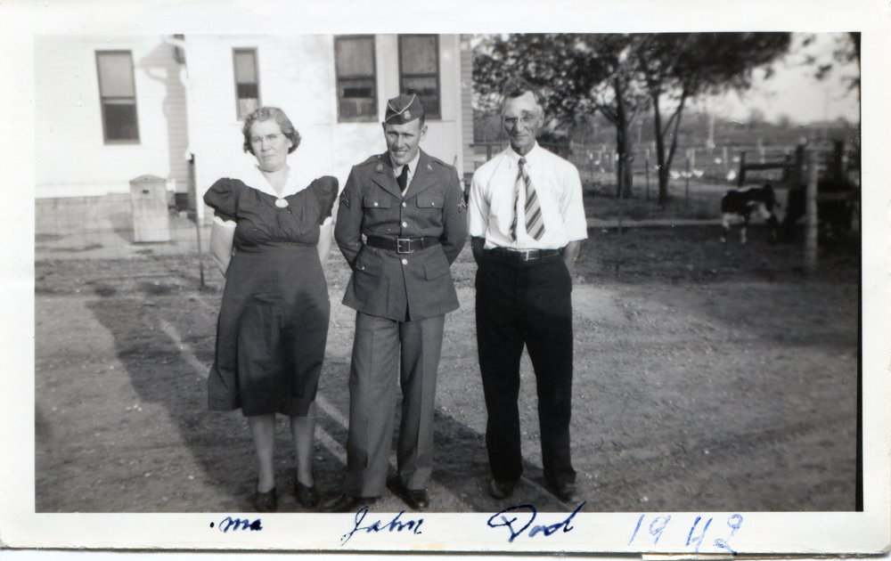 The Last Photo of John Saarloos taken with his Mother Tillie, and Step father, before he left home to serve in place of his brothers, to defend his country and liberate a continent from Evil. -He Would Never Return.