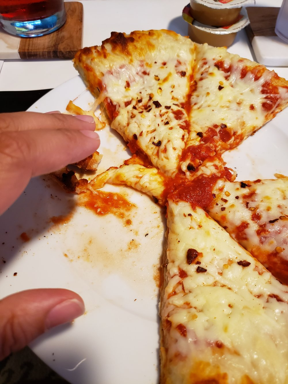 This left side of the pizza where my hand is