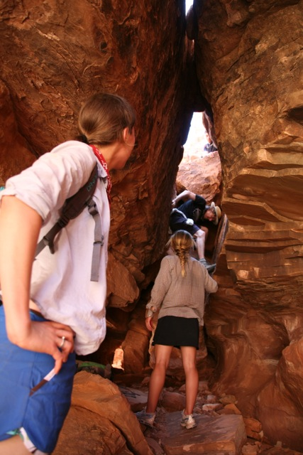 Climbing up into a slot canyon