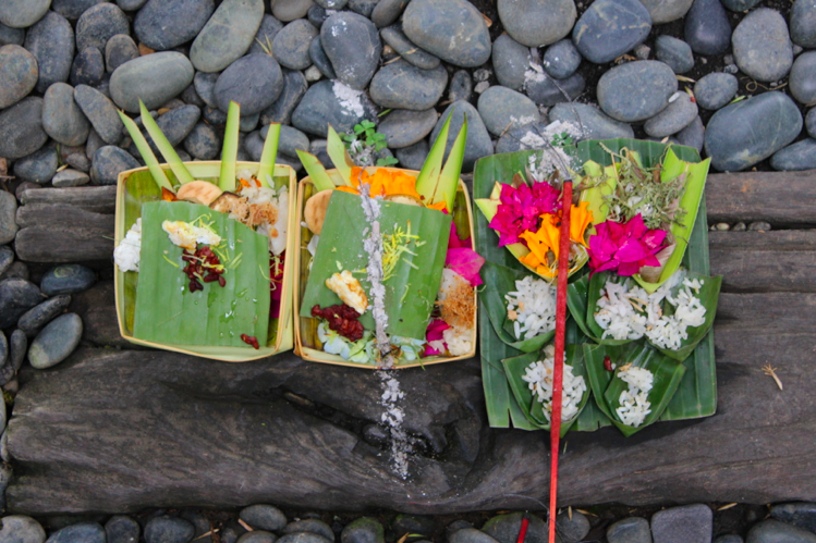 Offerings underfoot at a restaurant entrance