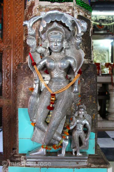 Hindu god sculpture with offerings