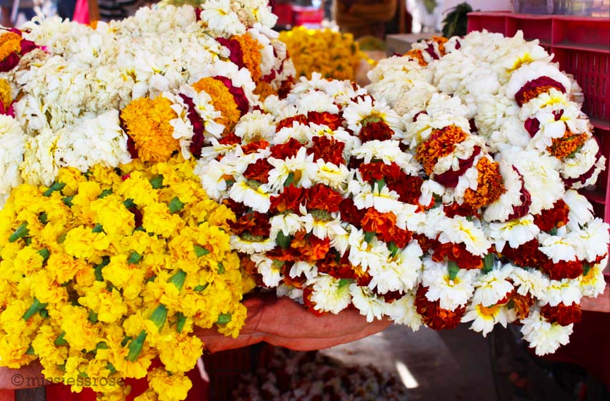 Floral garlands for sale, typically used as Hindu offerings
