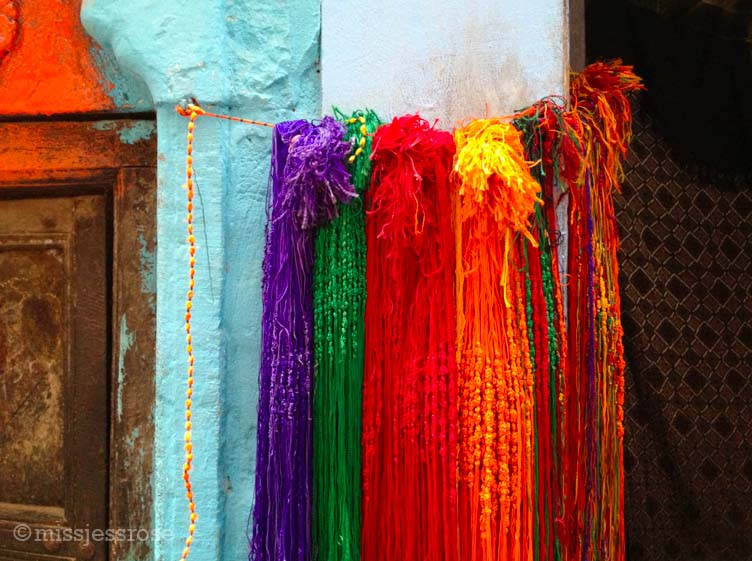 Colorful prayer bracelets for sale near a Hindu temple in Varanasi