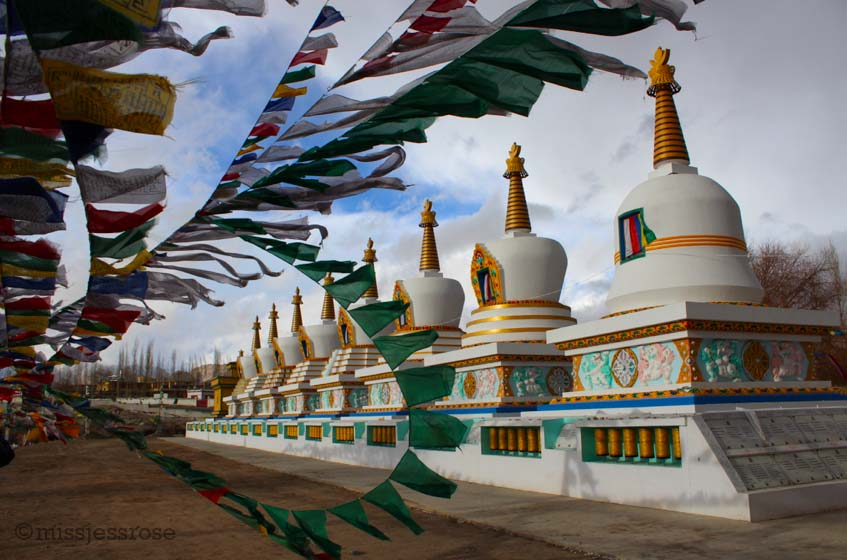 Tibetan Buddhist prayer flags and stupas in Ladakh, northern India