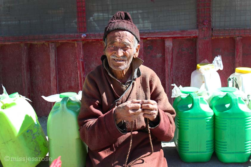 A Buddhist man saying his prayer beads near Alchi monastery in Ladakh, northern India
