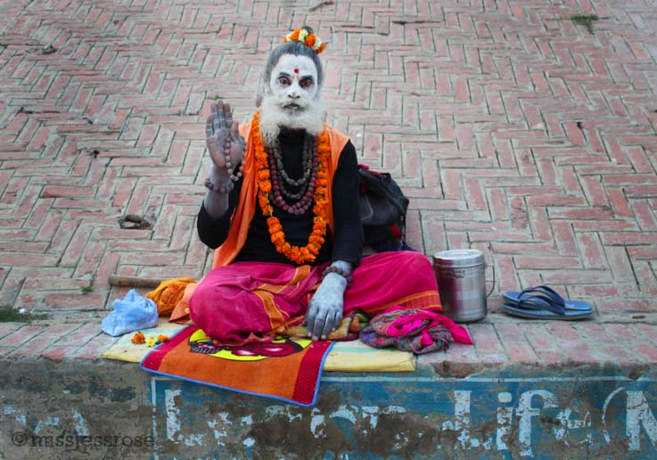 Sadu sitting by the Ganges river in Varanasi