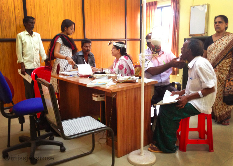 A very brief ear exam is conducted by a doctor in a communal room (Photo: C. Paine)