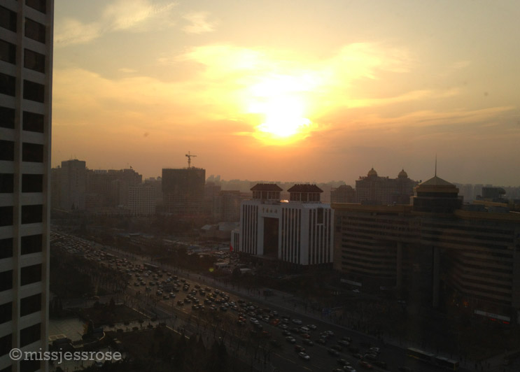 Hazy sunrise + traffic in Beijing