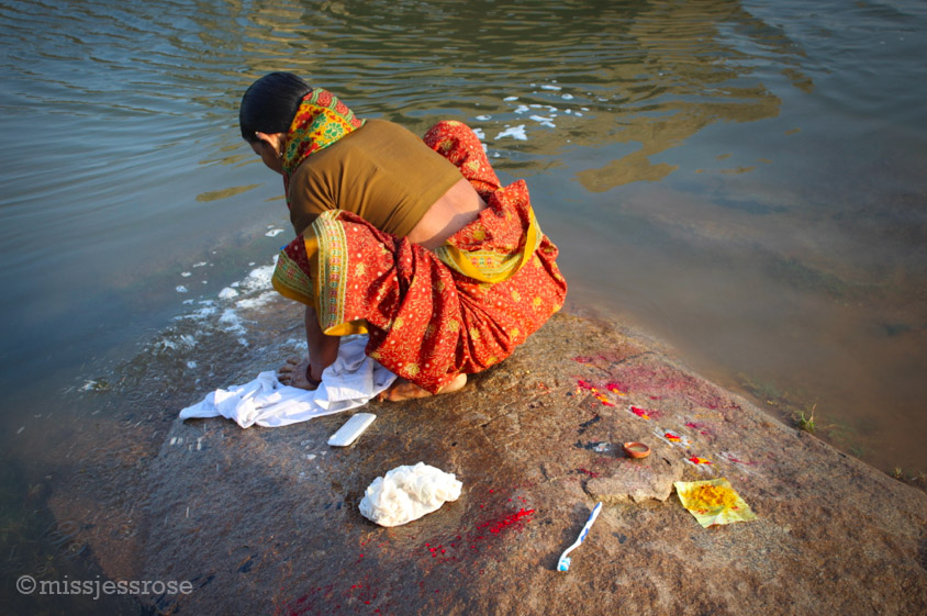 Women wash laundry in the river just a few rocks over