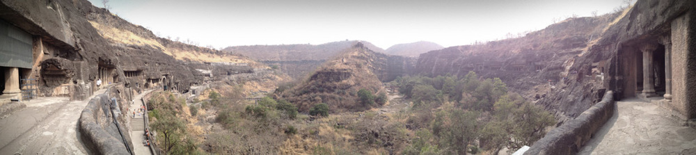 Panoramic view from the middle of the horseshoe-shaped ravine where the caves sit