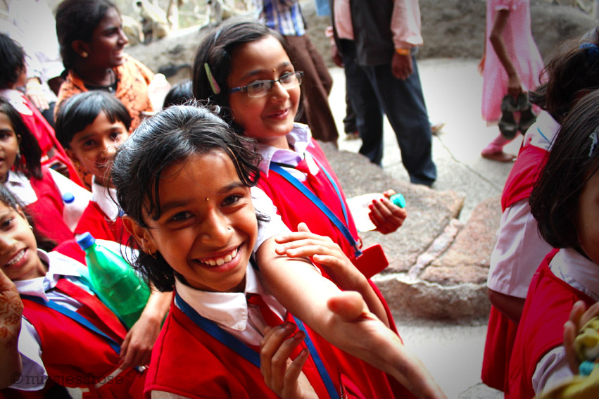 Sweet and charming school girls just want a handshake