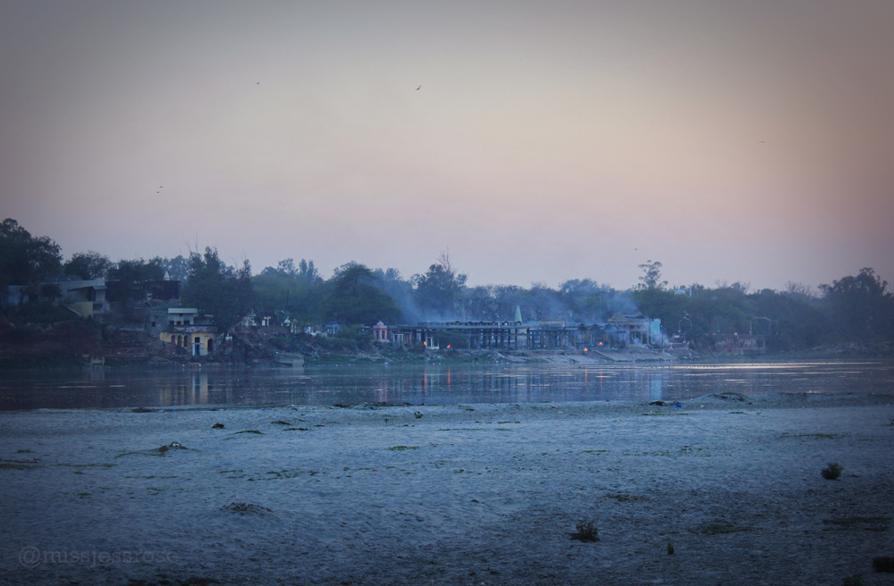 Fires burning alongside the Yamuna river near the Taj at dusk