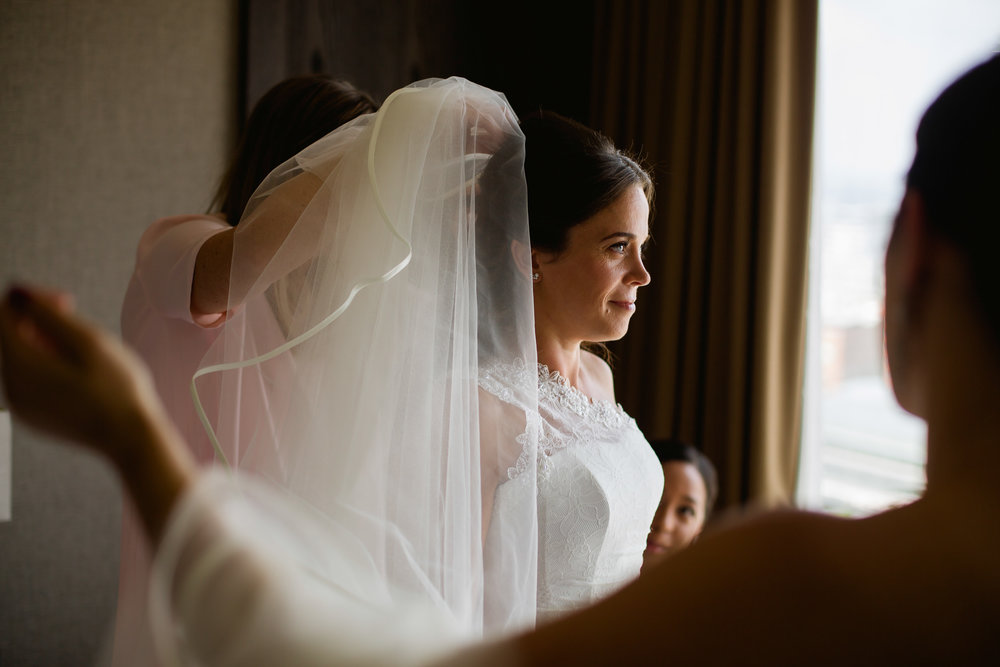 A bride getting dressed - hyatt Regency wedding Birmingham- Birmingham wedding