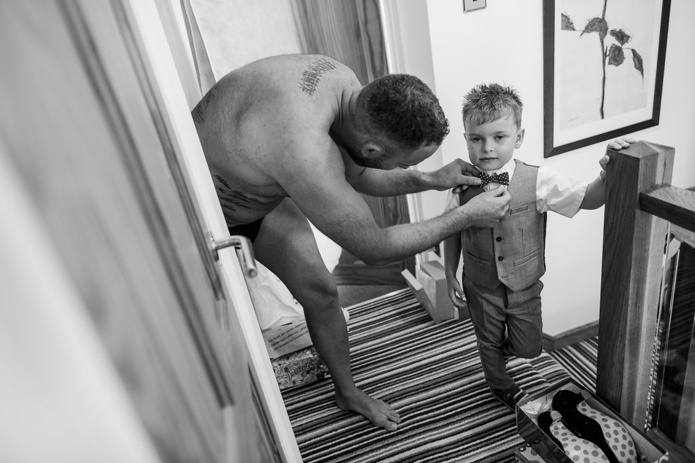 Boy getting dressed - wedding clothes - Yorkshire wedding