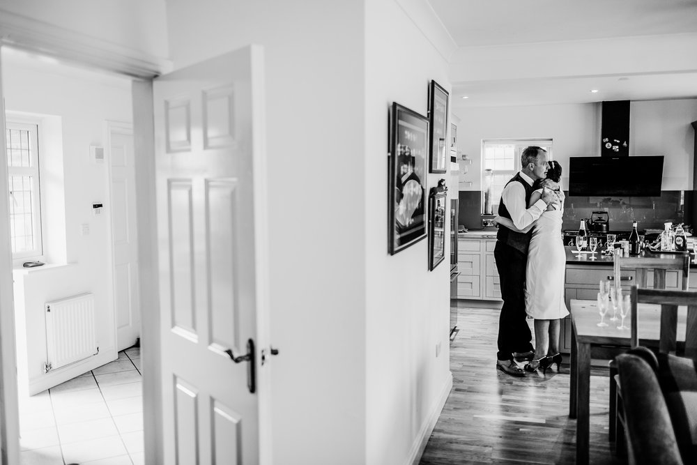 Bride and groom hug - wedding at home - Birmimgham wedding