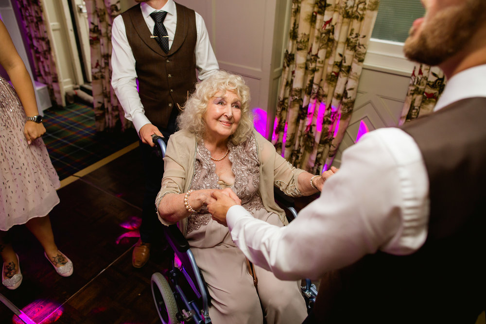 emotional wedding dance - grandmother dancing at a wedding - look of love