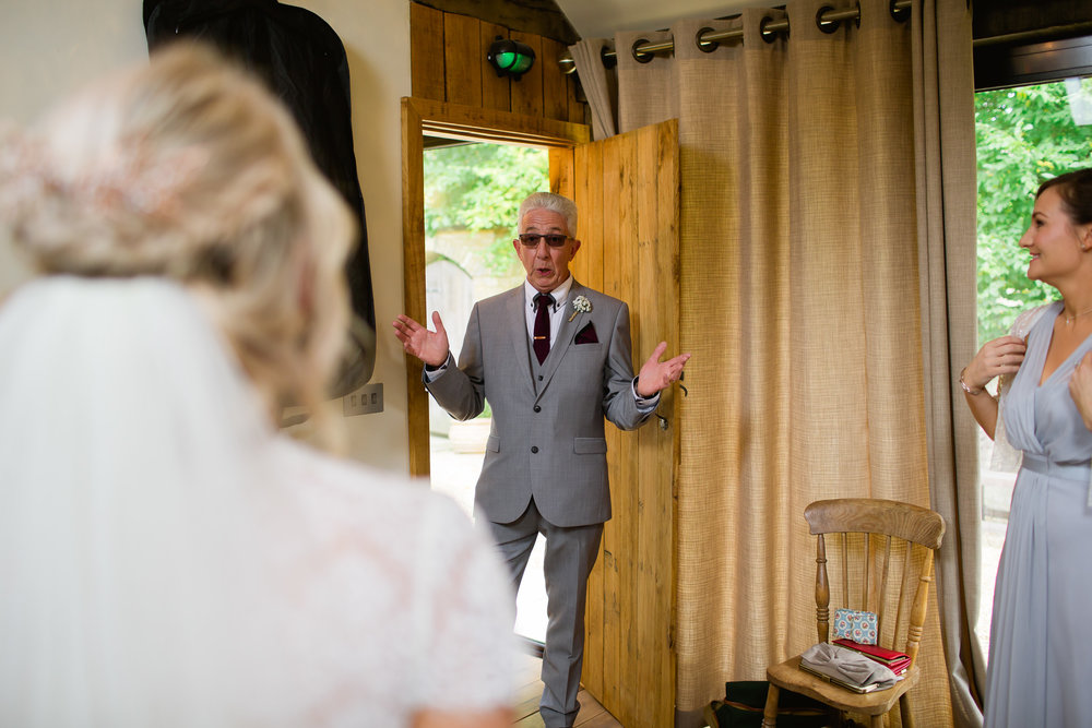 Fathers first look at his daughter on her wedding - wedding emotions - Tythe Barn wedding