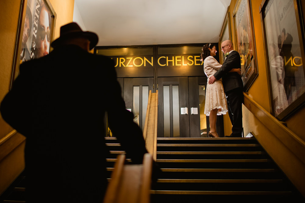 Bride and groom in a cinema chelsea London - Curzon london wedding - Kings road London wedding