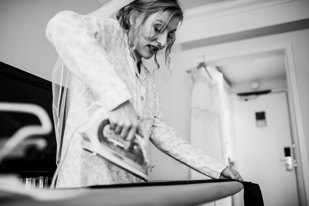 bride ironing her dress