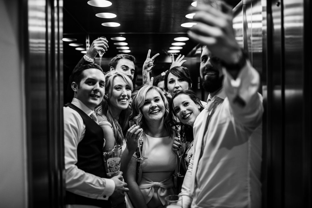 wedding guests in the lift at great john street hotel manchester