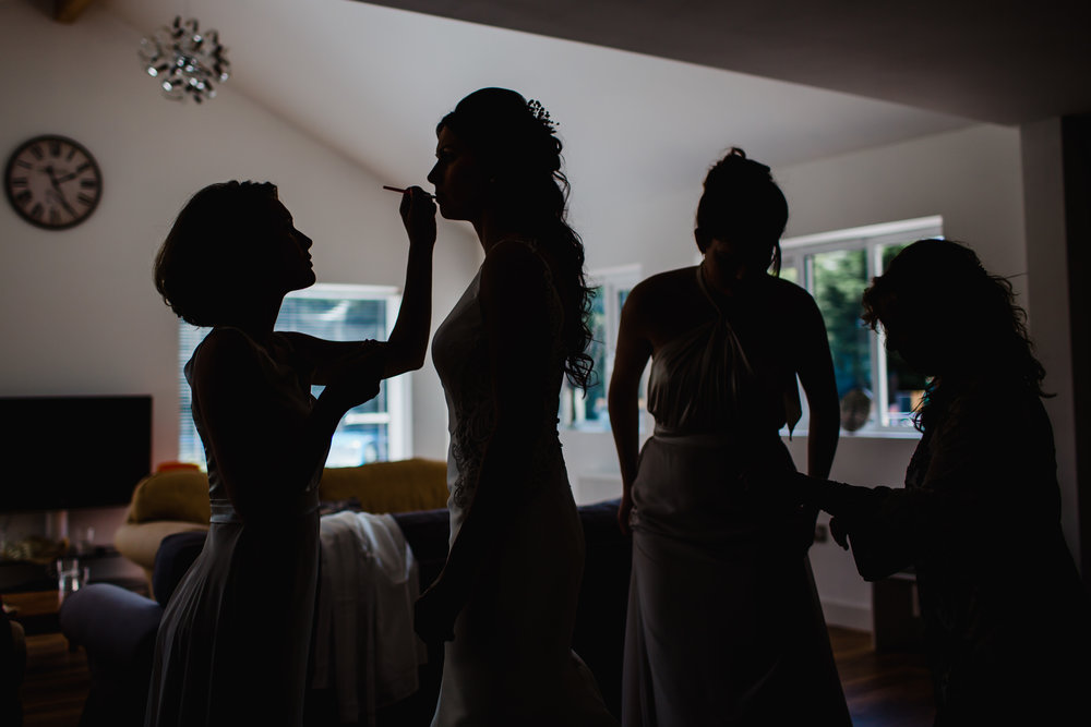 A bride finishes her make up before her wedding in the West Midlands.