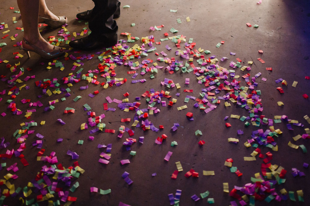 Spent confetti on the dance floor of a wedding