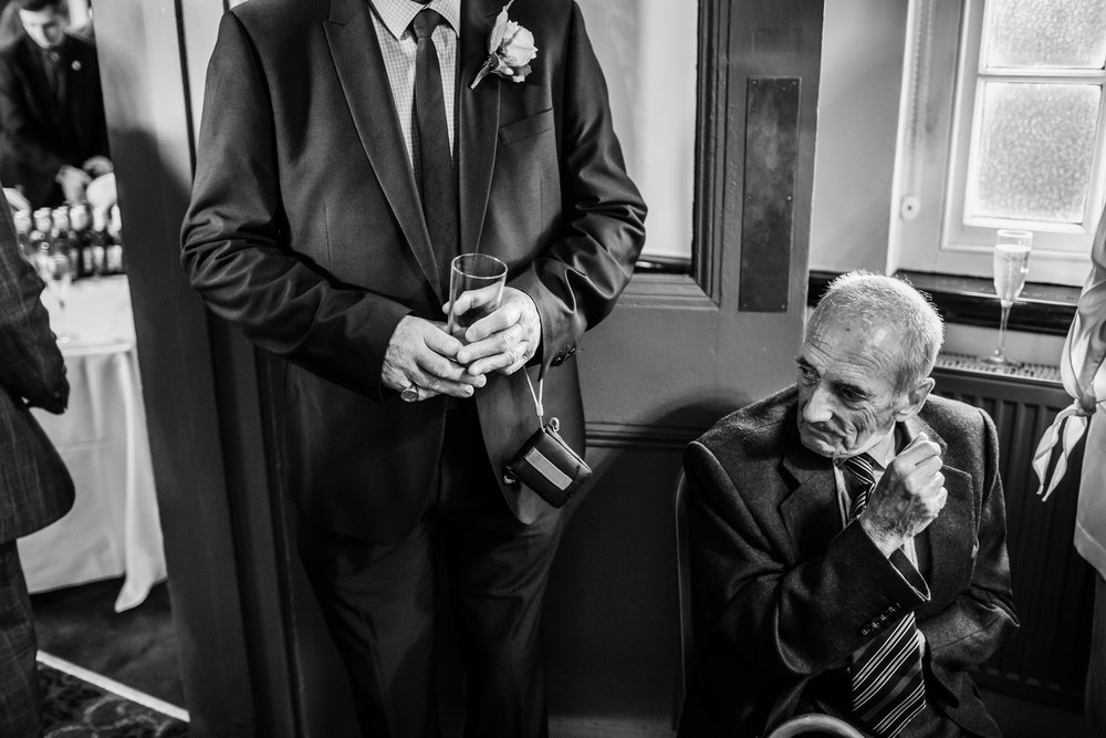 older guests at a wedding take a breather at the raven hall corby