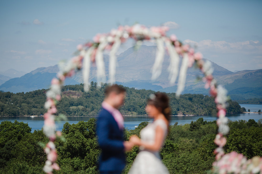 a wedding ceremony over looking loch lohmond