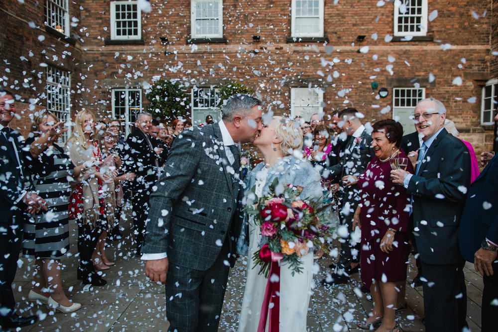 a bride, groom and all the confetti