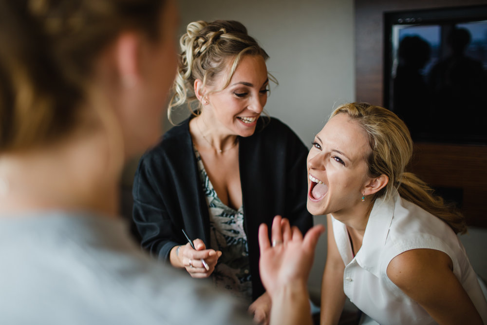 a bride laughs uncontrollably while getting ready at the clayton hotel Birmingham