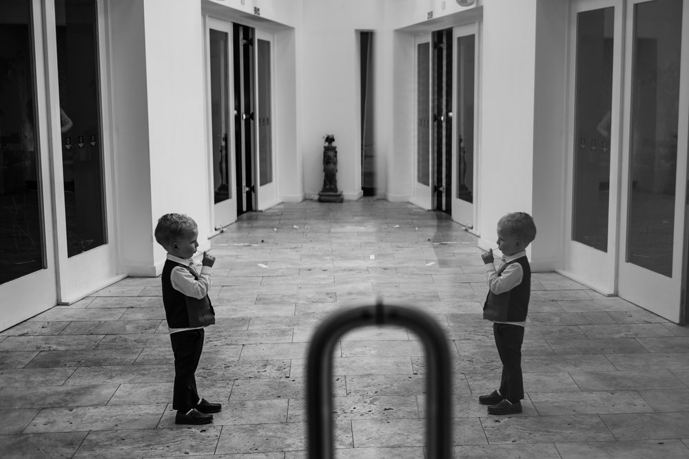 a small boy looks at his reflection at fazeley studio wedding