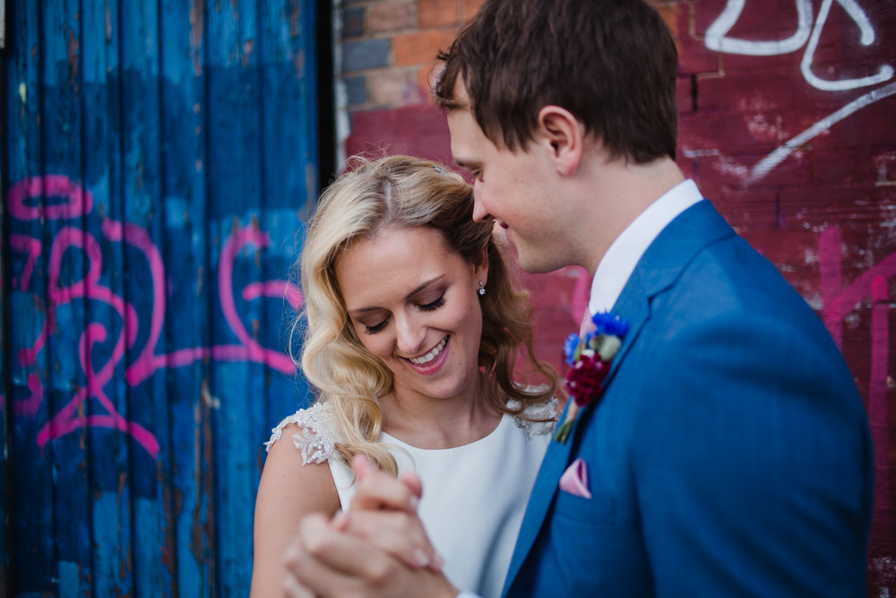 a bride, a groom, graffii in Digbeth Birmingham