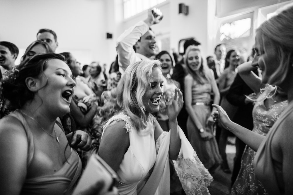 a bride dances hard with her wedding guests at fazeley studios Birmingham