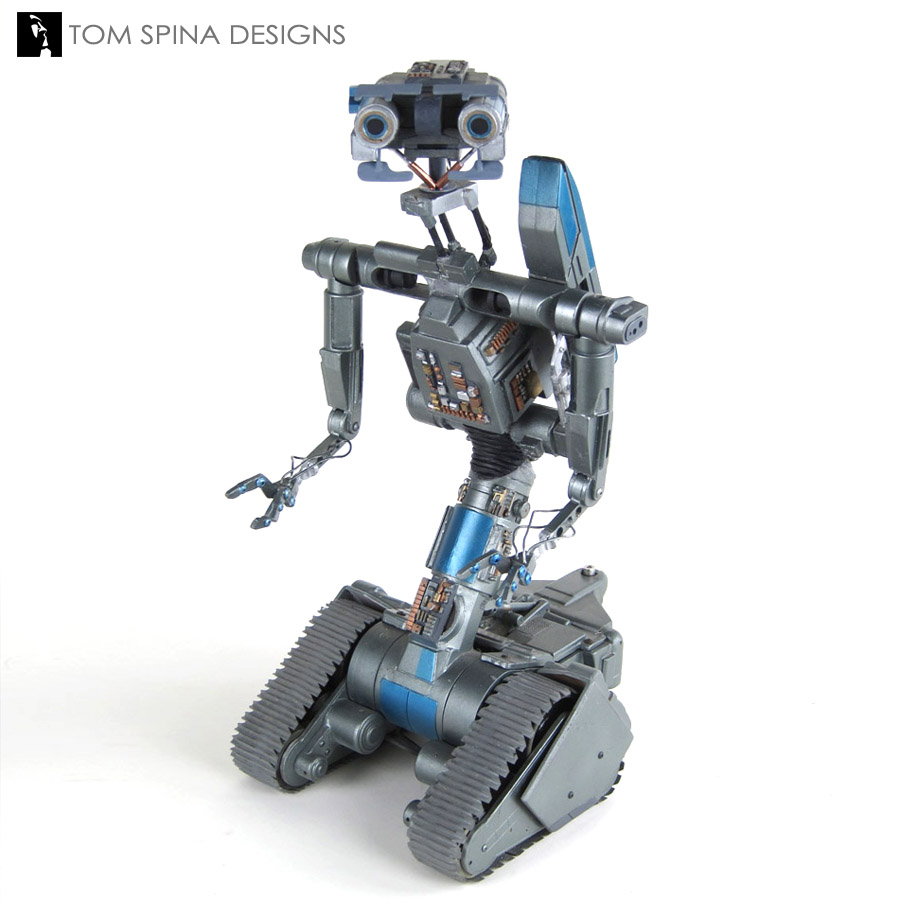A restored movie prop of Johnny Five by  Tom Spina Designs .
