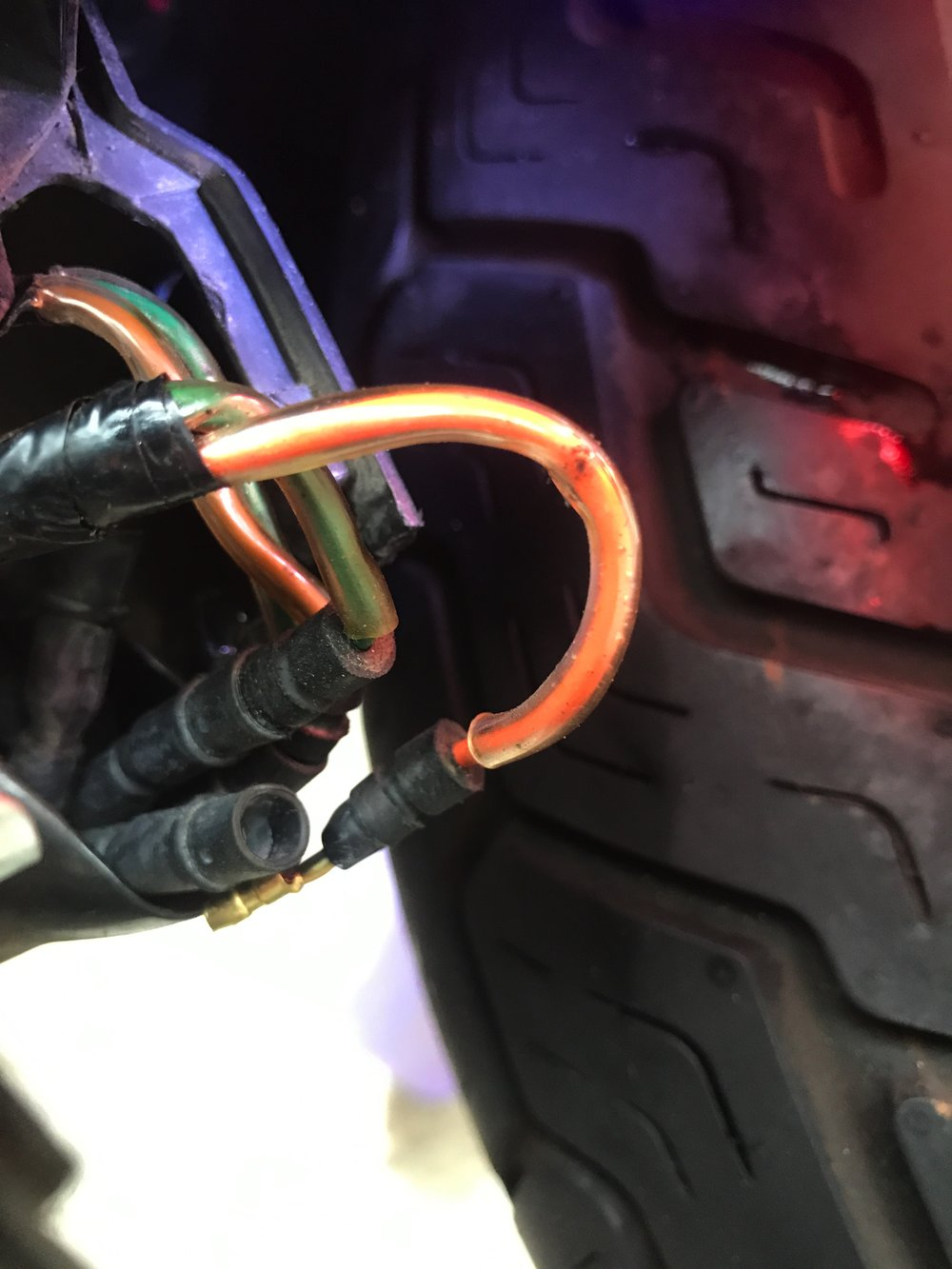 You can see the disconnected bullet connector hanging. Also, all the plastic and rubber used to protect against fender splashback.
