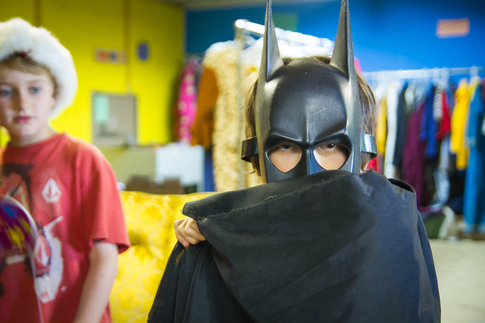 Batman costume at summer camp - photographer Travis Allison