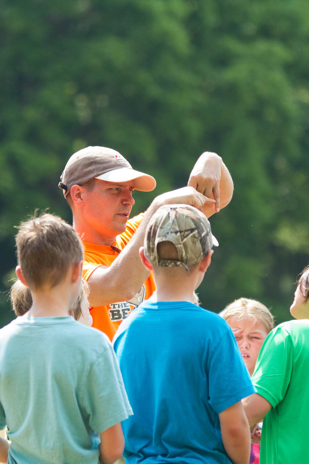 Summer camp counsellor teaching children