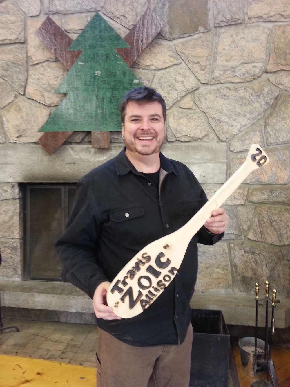 Travis Allison receives his  20 Year Paddle  from Cairn