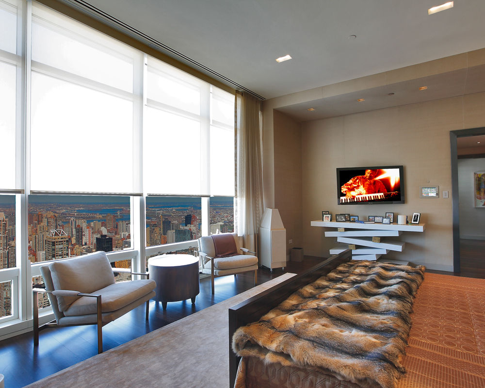 Our integrated control systems are acknowledged to be the very best in the industry as in this modern New York City apartment with Lutron lighting control system, and Lutron Sivoia QED motorized shades. Press the button labeled Summer Home and the shades, lights, and HVAC system are changed to pre-assigned settings.