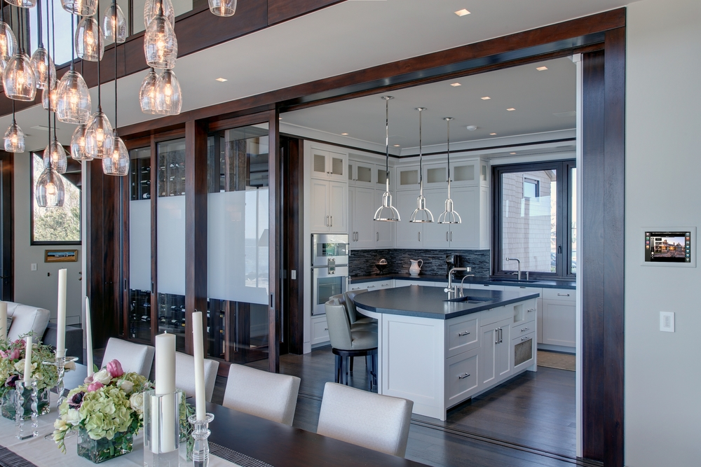 The control of light, home audio, video, communications, and security is a practical necessity, saving energy, improving livability, and providing a higher level of comfort and security. This Fairfield County residence incorporates a Savant integrated control system to provide these features.