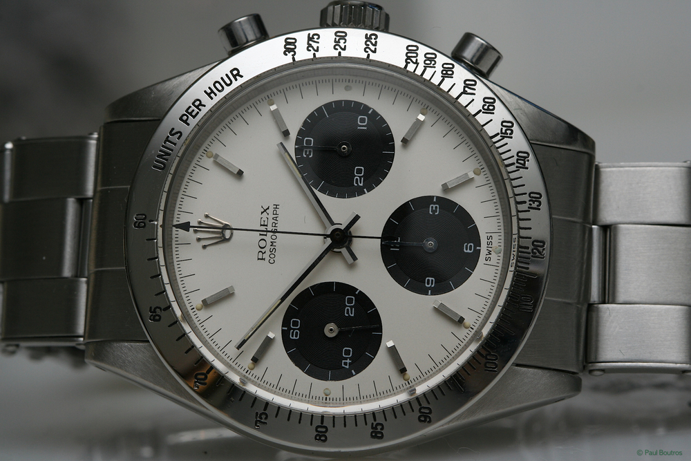 A 1963 Rolex Cosmograph Ref 6239 - Notice the hashed bezel to 300 units per hour and cream colored dial - both traits of the very early Daytonas