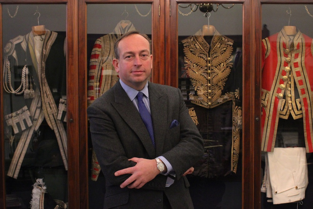 Simon Cundey, in front of some of the livery Henry Poole is responsible for.