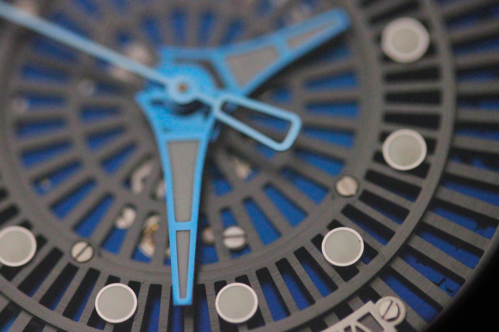 A Closer Look At The Skeletonized Dial, Superluminova Hour Markers, and Blue Hands