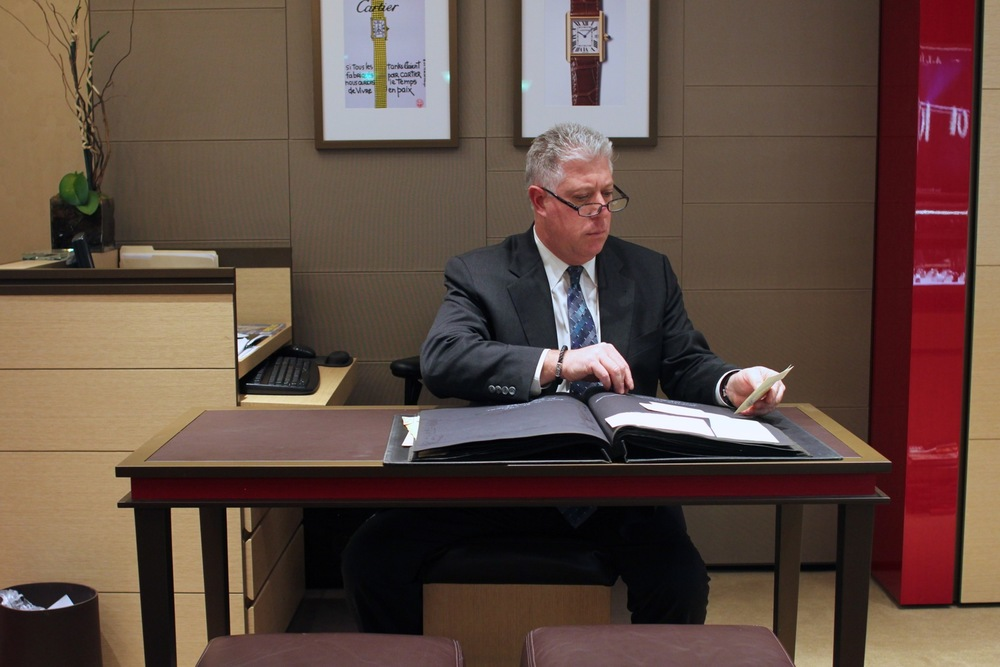 Richard Granatoor, William Barthman General Manager, Looks Through The Company's Archive Books