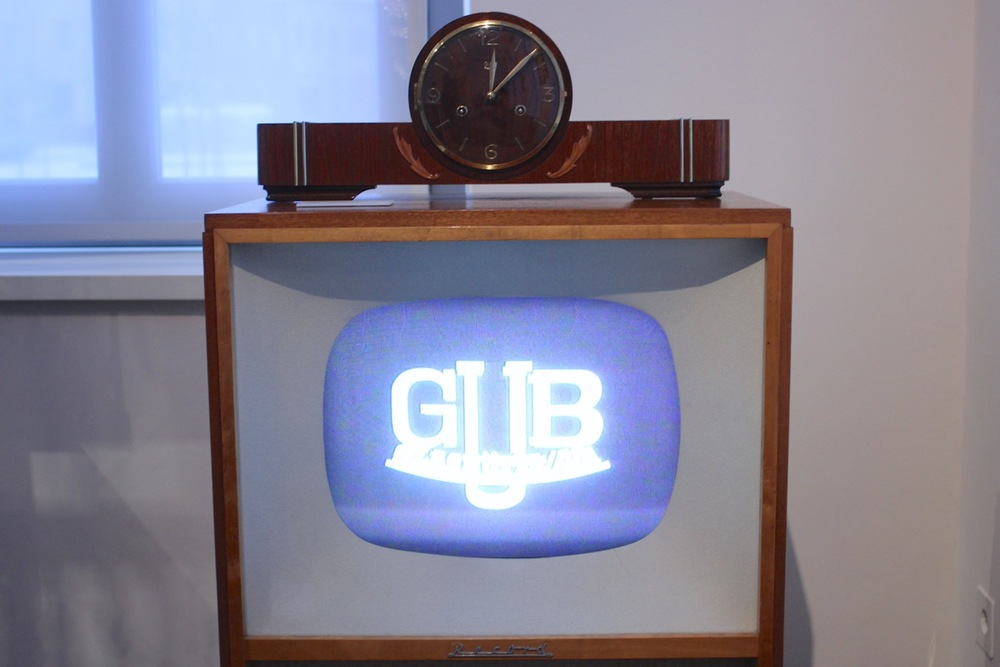 GUB TV clock, with original GUB advertisements running on the TV